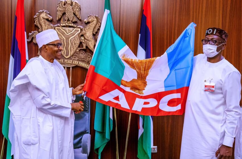 President Buhari presents APC flag to Edo Guber candidate, Ize-Iyamu in Aso Rock