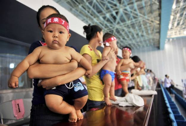 Policy: China allows couples to have three children