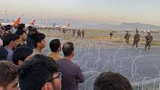 US troops fire shots in air at Kabul airport as crowd mobs tarmac