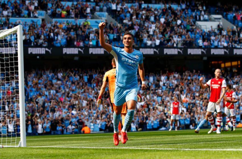 Man City dominate 10-man Arsenal to go top